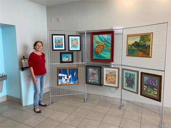Irmi Presutto with her displayed artwork