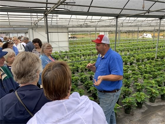 Farm tour attendees at the poinsettia farm
