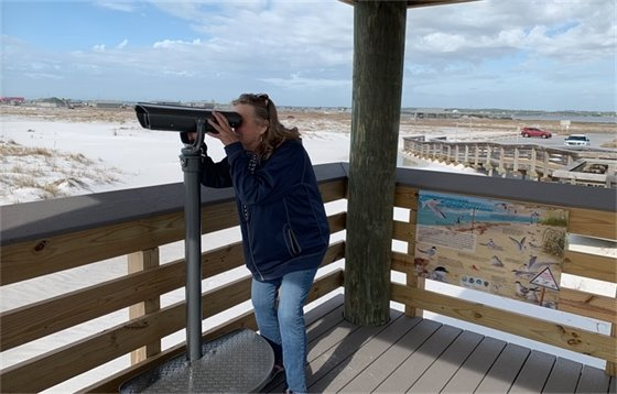 Chris Verlinde, UF/IFAS Extension Florida Sea Grant, using the new binoculars at Navarre Beach