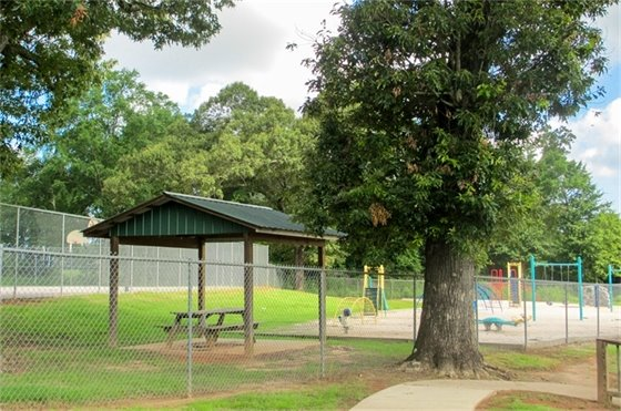 Fidelis Park in Jay, FL showing pavilions, a playground, walking bath and basketball court