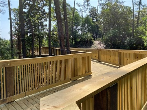 Picture of a boardwalk that is part of the Godwin Connector trail in Gulf Breeze that can be accessed from either Soundside Drive or Madura Road.