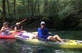 Man kayaking down river with the Florida Master Naturalist Program