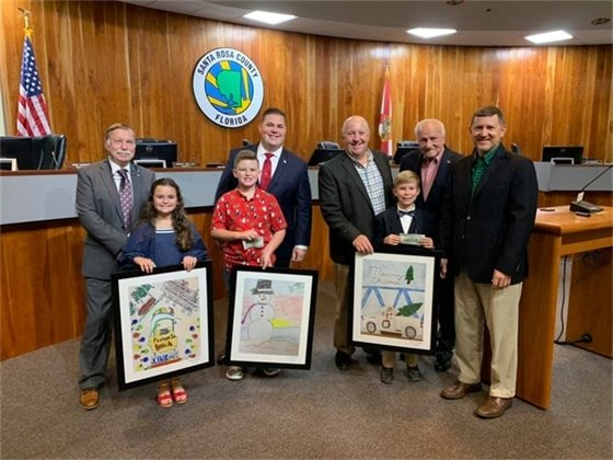 Commissioners and the winners of the art contest