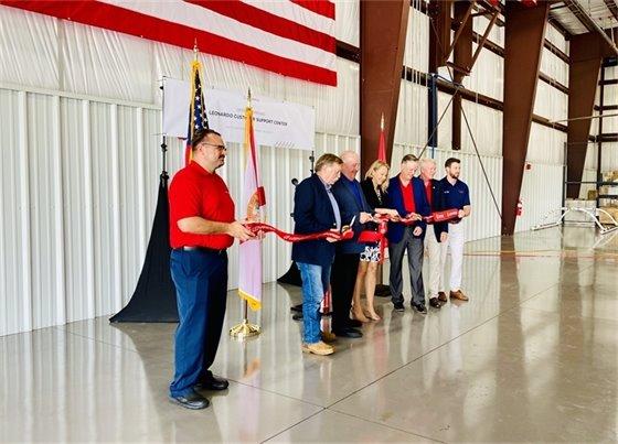 Officials from Santa Rosa County and Leonardo cut the ribbon on a new hangar at Peter Prince Airport