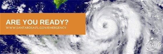 Are you ready? www.santarosa.fl.gov/emergency. Photo of a hurricane behind text.