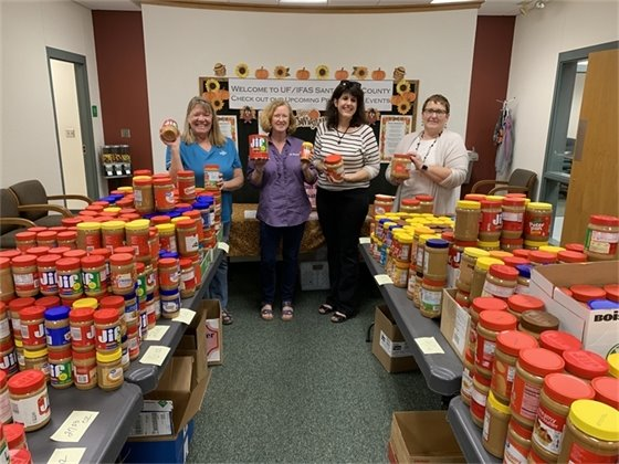 Chris Verlinde, Mary Salins, Ginny Hinton and Mary Mabie stand with 2019 peanut butter donations