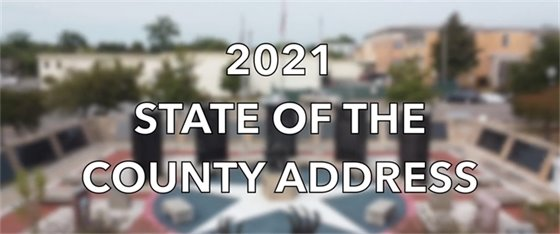 2021 State of the County Address with photo of the Veterans Memorial Plaza in Downtown Milton behind it